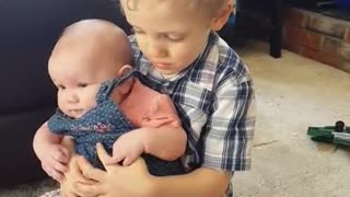 Sweet Little Boy Preciously Sings To His Baby Sister - Video