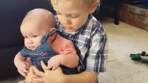Sweet Little Boy Preciously Sings To His Baby Sister