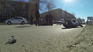 Motorcycle Rides Between Lanes and Crashes - Video