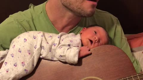 Dad Serenades Newborn Baby To Sleep On Guitar