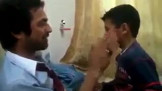 Slapping each other father and son - Video