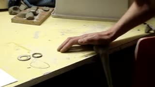 Making a clay pottery tea pot on the wheel - Video