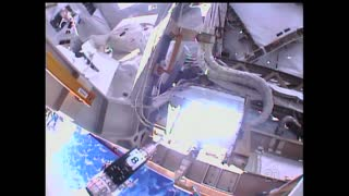 Astronauts Replace Backup Computer During Spacewalk - Video