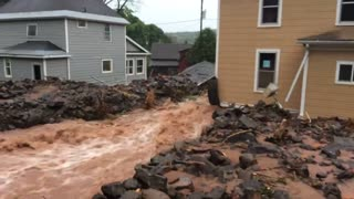 Flood Waters Rip Through Houses - Video