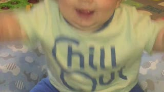 Baby so excited to be on camera he falls over!