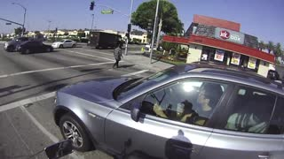 Motorcyclist Startles Driver For Running Red Light