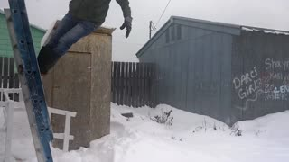 Lady jumps off ladder to snow - Video