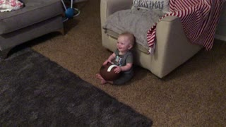 Giggling baby finds daddy's football noises hilarious - Video