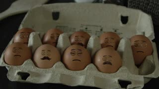 Man making eggs with faces on them