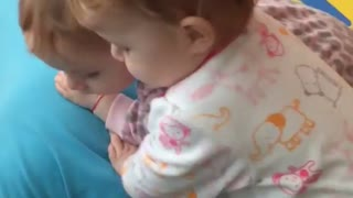 Twin babies confused by snoring grandpa - Video