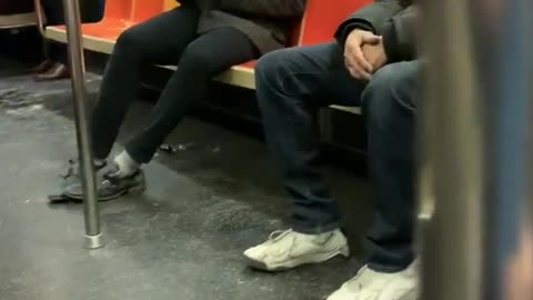 Guy sucks air out of canned air duster on subway train
