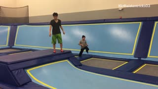 Music black shirt backflip on blue trampoline lands on head