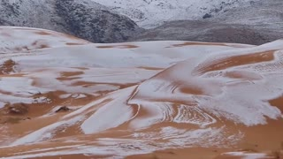 Snow Whitens Sahara Desert in Algeria - Video
