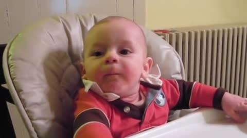 What a heavy reaction of hungry baby on receiving food