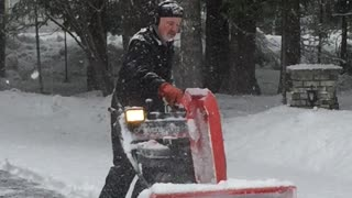 Man Busts a Moves While Plowing Snow - Video
