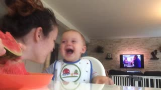Baby laughs to tears when mommy eats watermelon - Video