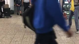 Big lady yellow bikini dancing with man subway - Video