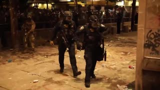 Portland Cop Limps Away After Being Injured By Rioters