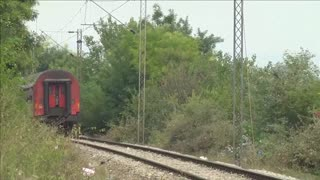 Migrants board train in Macedonia