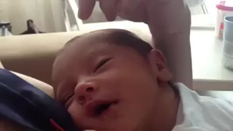 Adorable baby smiles for the first time