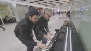 Three piano dudes boogie woogie at the airport - Video