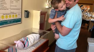 Brother meets baby sister for the first time  - Video