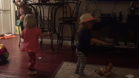 Two Year old twins a have a dance party