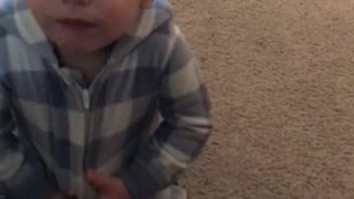 Baby can't find ball in his Onsie  - Video