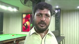 Born without arms, Muhammad Ikram masters the game of snooker
