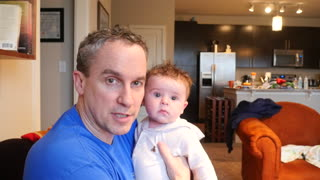 Baby boy cracks up from instructional video - Video