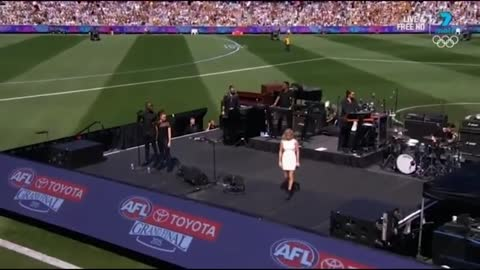 Lip-syncing? Ellie Goulding performs at the AFL Grand Final