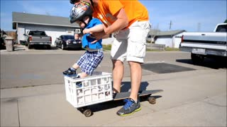 Brave toddler loves riding longboard - Video