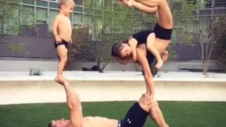 Acrobat parents entertain kids in best possible way - Video
