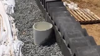 Builders Top Wall With Dazzling Domino Brick Chain Reaction  - Video