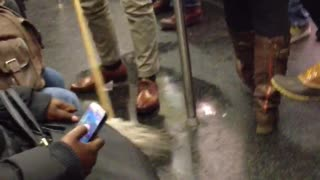 Man mopping the subway floors