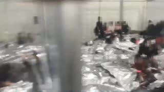 Incredible footage of inside Biden's kids in cages facility.