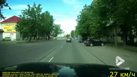 Motorcycle collision into turning car
