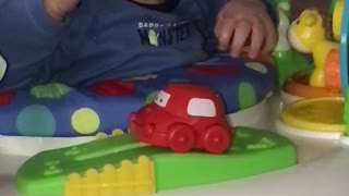 Bouncing Baby Boy Loves His Toys - Video