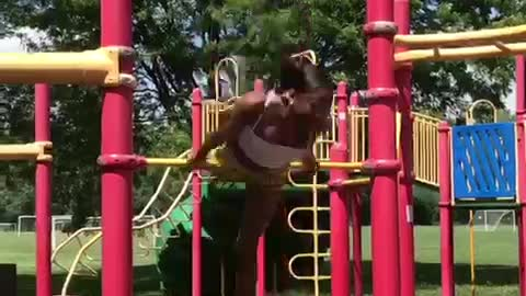 Woman performs insane flips on playground bar