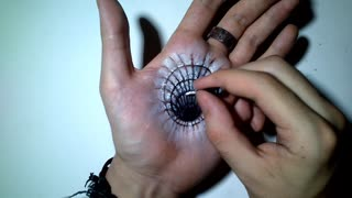 Artist Creates A Hole In His Palm For The Sake Of Art  - Video