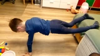 Funny kid trying to get strong