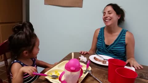 Dinner turns into adorable dance party with mom and toddler