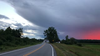Cyclist Stops for Epic Sunset as Storm Approaches