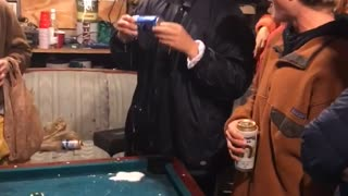 Guy playing pool hits drink with ball - Video