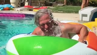 Collab copyright protection - old guy floatie into pool slide
