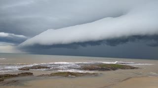 Intense Stormcloud Sweeps Across Sea