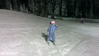 Talented Six-Year-Old Girl Tackles The Ski Slopes At Night - Video