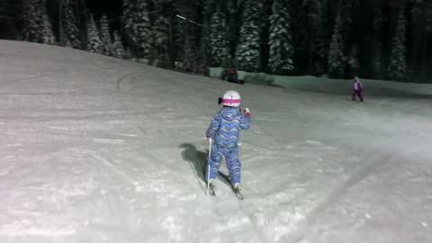 Talented Six-Year-Old Girl Tackles The Ski Slopes At Night
