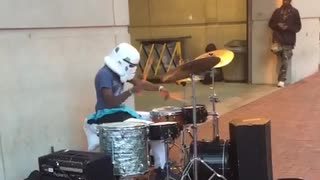 Playing drums with storm trooper mask on