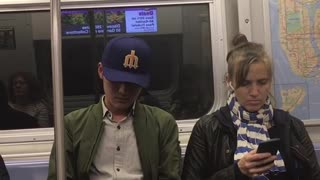Guy blue hat green jacket falling asleep wobbling around - Video